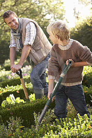 Young man with child working in garden