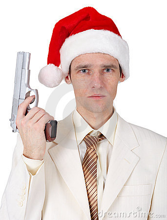 Young man in Christmas hat with gun