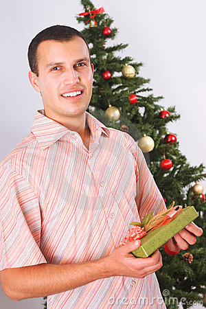 Young man with christmas present