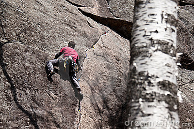 Young man climbing in Quebec