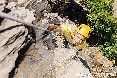 Young Man Climbing Rock