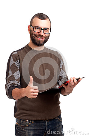 Young man with clipboard gesturing thumbs up