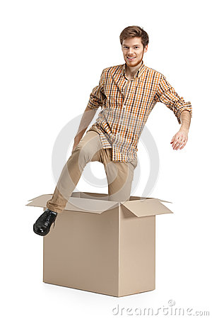 Young man comes out of the cardboard box