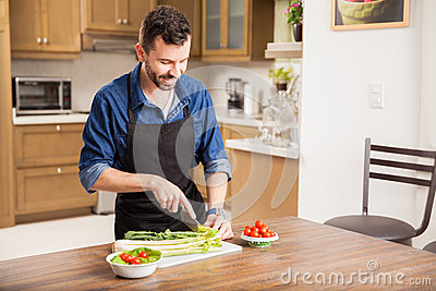 Young Man Cooking At Home Stock Photo - Image: 62897256
