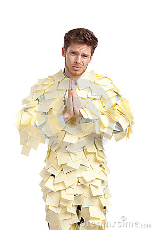 The young man covered with yellow sticky notes