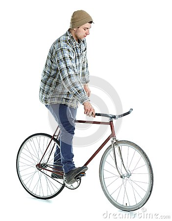 Free Young Man Doing Tricks On Fixed Gear Bicycle On A White Stock Image - 54604571
