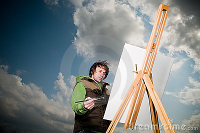 Young man drawing outdoors