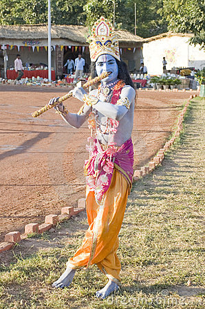A young man dressed as Lord Krishna