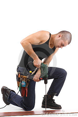 Young man drilling