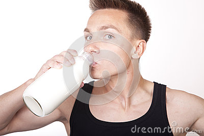 Young man drinking a milk