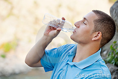 Young man drinking water