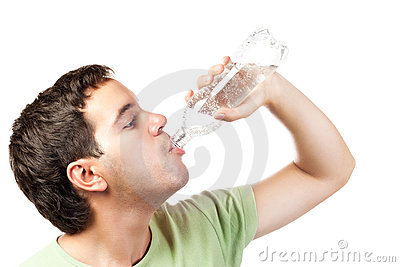 Young man drinking water from bottle isolated