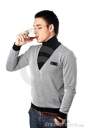 Young man drinking whiskey