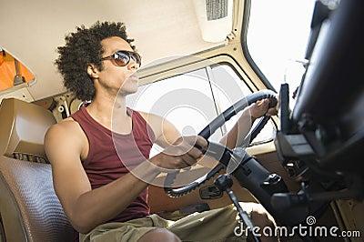 Young Man Driving Campervan