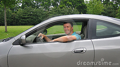 Young Man Driving Sports Car