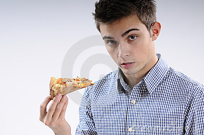Young man eating pizza