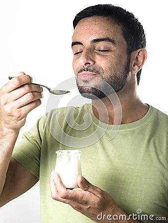 Young Man Eating Yogurt