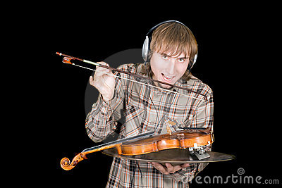 The young man eats a violin