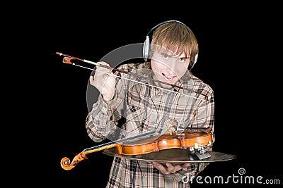 The young man eats a violin