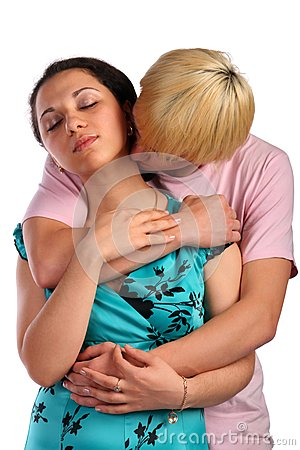 Young man embrace girl from behind