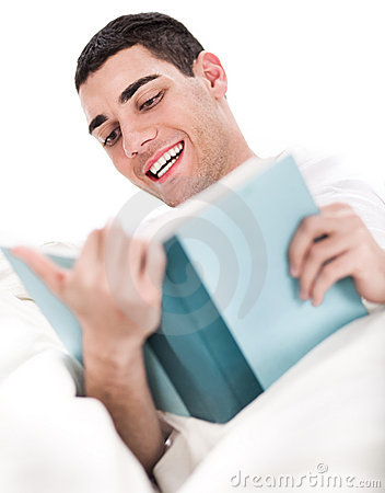 Young man enjoy reading book