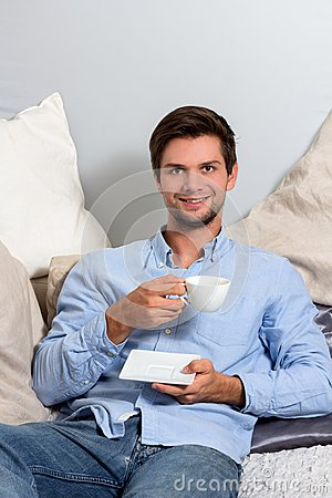 Young Man Enjoying A Coffeebreak Royalty Free Stock Photo - Image: 26496995