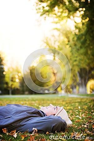 Young man enjoying fall