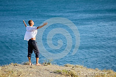 Young man enjoying the sea breeze