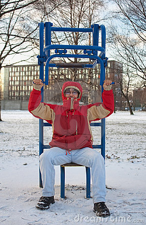 Young man exercising in winter park