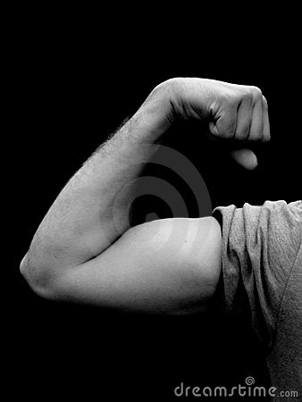 Young man flexing muscle in black and white