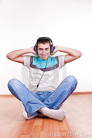 Young man on the floor with earphones