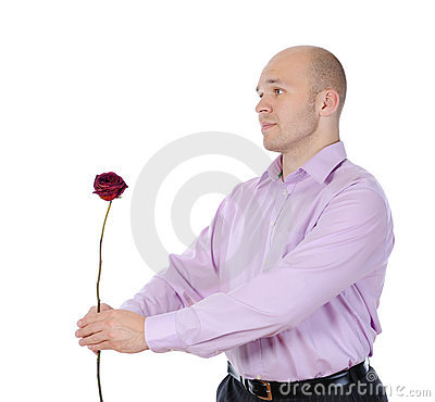 Young man with a flower in her hand.