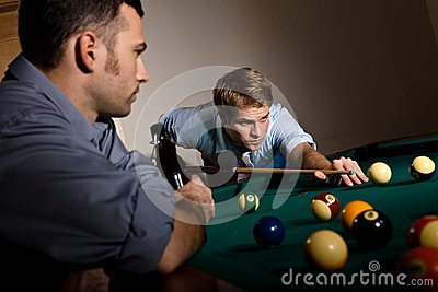Young man focusing on playing snooker
