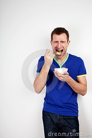 Young man forced to eat yogurt