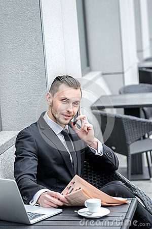 Young man in formal wear talking on the phone