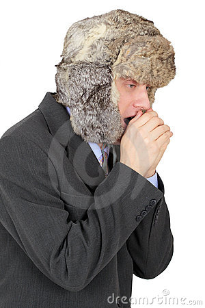 Young man in fur cap freezes