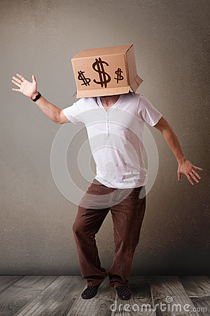 Young man gesturing with a cardboard box on his head with dollar