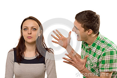 Young man gesturing at his girlfriend