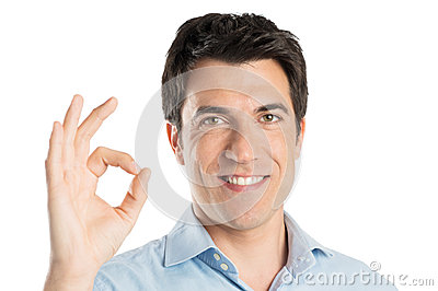 Young Man Gesturing Ok Sign