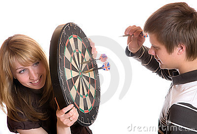 The young man and girl play a darts
