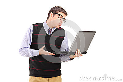 Young man giving a kiss at a laptop computer