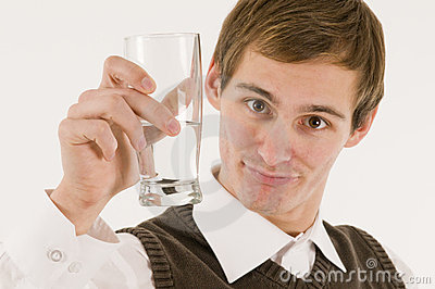Young man with glass of water