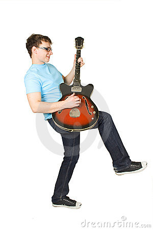 Young man in glasses playing guitar isolated