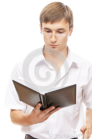 Young man in glasses reading book