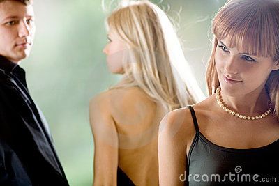 Young man going with girlfriend and looking at young woman