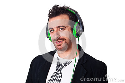 Young man with green headphones listening to music