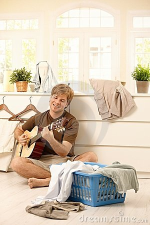 Young man with guitar and laundry