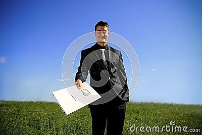 Young man handing a folder