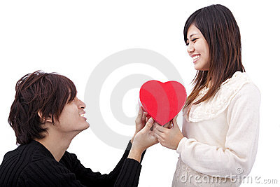 Young Man handing over love gift  to  woman
