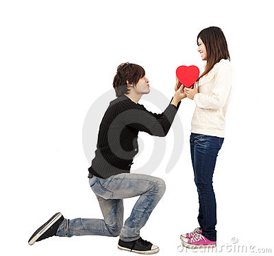 Young Man handing over love gift  to  young woman